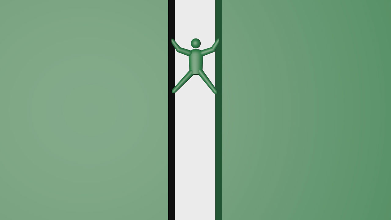 壁を上る男